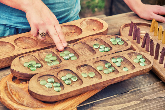 Vari (Ovare) is a board logic game for two from the family of mancala games. People play an ancient board game of the Mancala, Kalah.