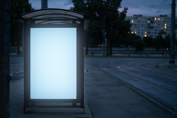 billboard at the bus stop outdoor ad.bus shelter with white field glowing at night in the city mockup advertisement. Fotomurales