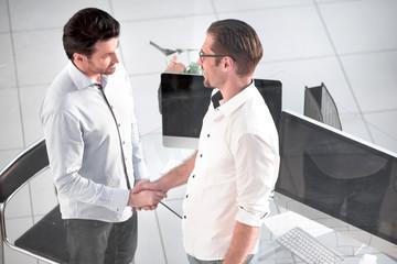 handshake business people near the desktop.