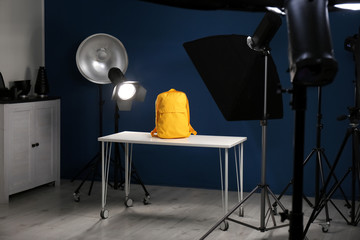 Shooting of bright backpack for product promotion in photo studio