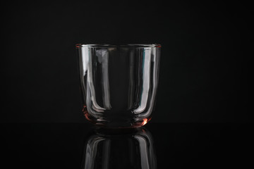 Spoed Foto op Canvas Alcohol Elegant empty colorful whiskey glass on black background