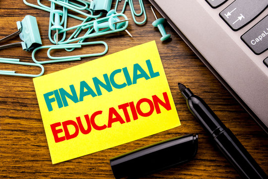 Handwriting Announcement text showing Financial Education. Business concept for Finance Knowledge written on sticky note paper on wooden background next to the laptop keyboard With marker