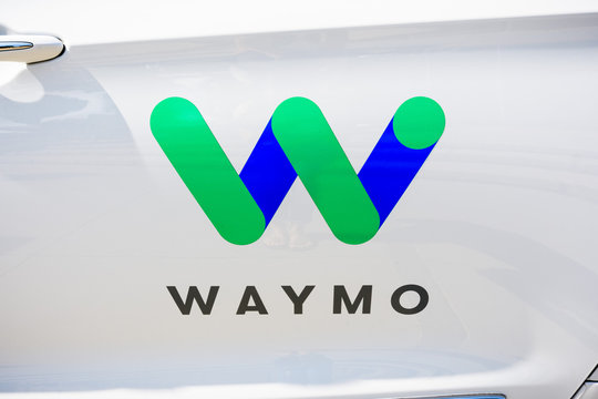 September 27, 2018 Sunnyvale / CA / USA - Close up of Waymo logo on the side of one of their self driving cars, in testing at this moment on the streets of Silicon Valley