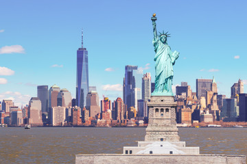 Fototapete - The Statue of Liberty with the One world Trade building center over hudson river and New York cityscape background, Landmarks of lower manhattan New York city.