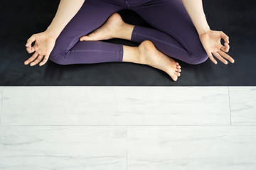 Top view and closeup photo of people posing a yoga in gym. Exercise and meditation concept with free space for text.