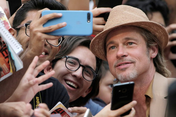 """Brad Pitt poses for a photo with fans during the red carpet for """"Once Upon a Time in Hollywood"""" in Mexico City"""