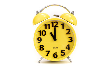 Yellow alarm clock on white at 11 o'clock