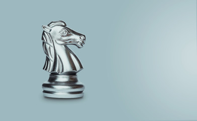 Knight chess isolated on gray background