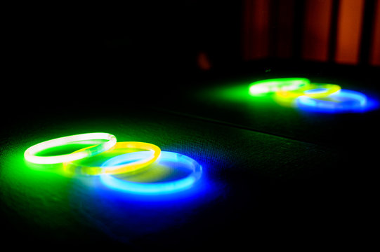 Neon glow stick bracelets in a pile