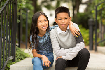 Portrait of an Asian brother and his little sister.