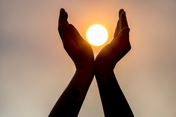 Holding the sun in two hands.