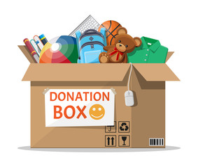 Cardboard donation box full of toys, books, clothes and devices. Help for children, support for poor kid. Social care, volunteering and charity concept. Vector illustration in flat style