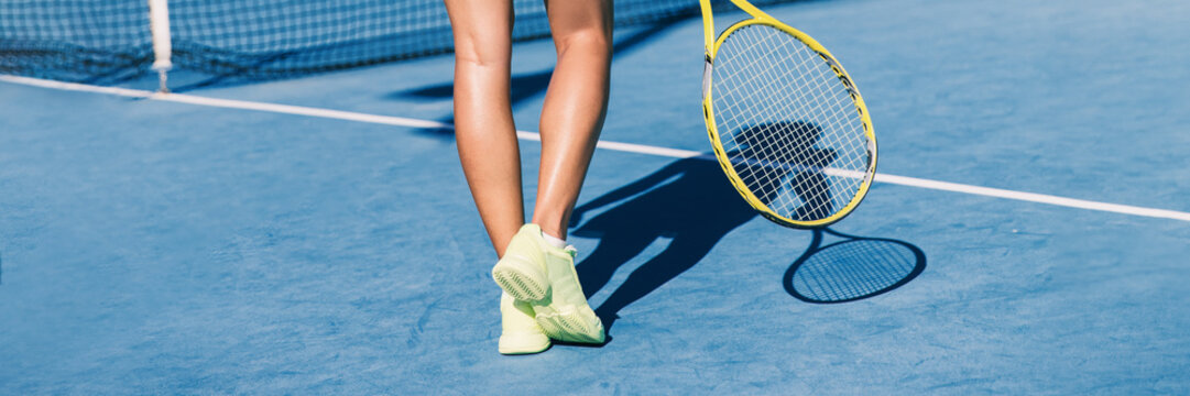 Tennis player woman shoes and racket on blue hard court background panoramic banner of athlete ready to play game. Sport exercise lifestyle.