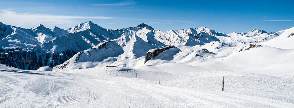 Sunny winter day in alpine ski resort