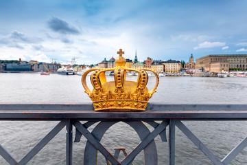 Gilded crown at the middle of Skeppsholmen bridge at Stockholm, Sweden Fototapete