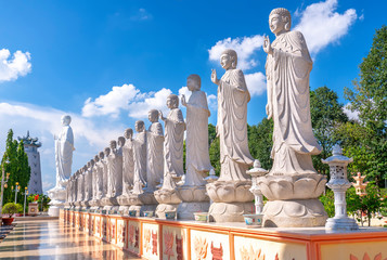 Beauty architecture leads to Lord Buddha statue shining in Dai Tong Lam Pagoda, which attracts tourists to visit spiritually on weekends in Vung Tau, Vietnam