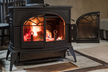 burning wood in the stove in country house
