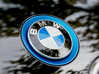 STRASBOURG, FRANCE - MAY 30, 2017: Side view of blue BMW logotype on the electric i1 limousine
