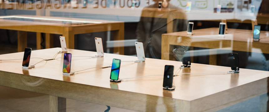 STRASBOURG, FRANCE - NOV 3, 2017: Latest Apple iPhone X goes on sale in Apple Store worldwide - store reflection with human silhouette