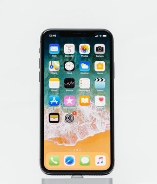 PARIS, FRANCE - NOV 5, 2017: New Apple iPhone X 10 smartphone isolated white background with home screen apps
