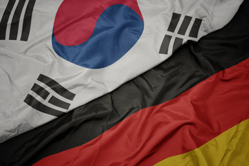 Fotobehang Seoel waving colorful flag of germany and national flag of south korea.