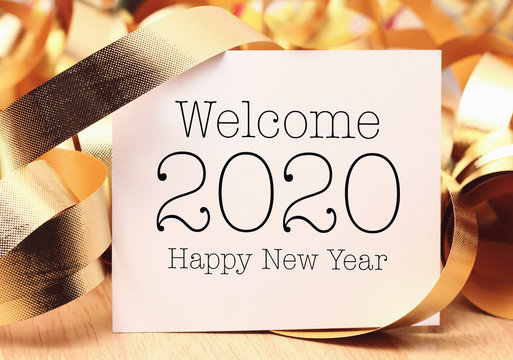 Welcome 2020 with gold decoration.