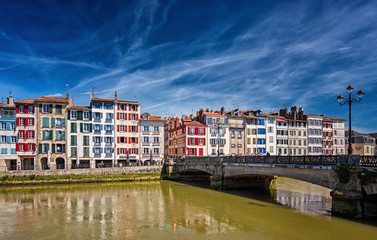 Colorful houses at the Nive river embankment in Bayonne, France