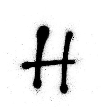 graffiti thin H font sprayed in black over white