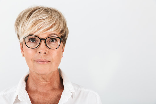Portrait closeup of caucasian middle-aged woman wearing eyeglasses looking at camera