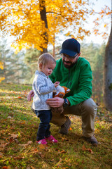 father and daughter in the autumn park