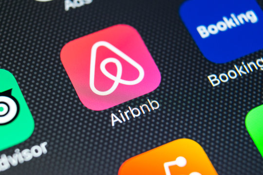 Sankt-Petersburg, Russia, February 9, 2018: Airbnb application icon on Apple iPhone X screen close-up. Airbnb app icon. Airbnb.com is online website for booking rooms. social media network.