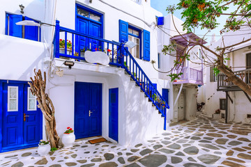Mykonos, Greece famous island street view with white and blue houses in Cyclades