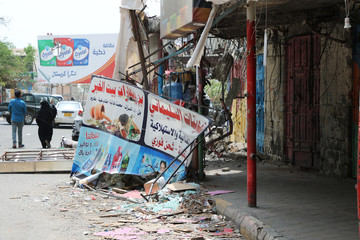 Shops damaged during clashes between separatists and government forces are pictured in Aden