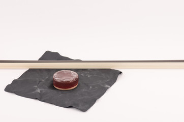 violin bow and rosin - objects and materials still life