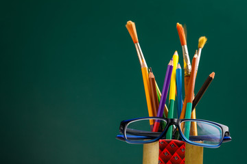 The concept of the teacher's day, School stationery, pencil, pen, note, Spectacles in pen box