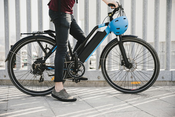Fototapeta Urban cyclist taking a brake on e-bike obraz