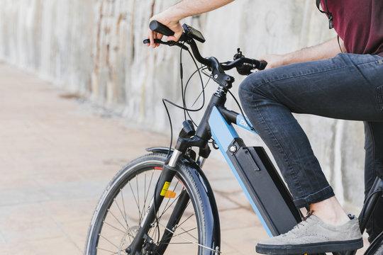 Close up man riding an e-bike
