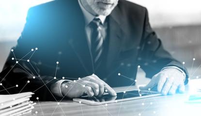 Senior businessman using a digital tablet