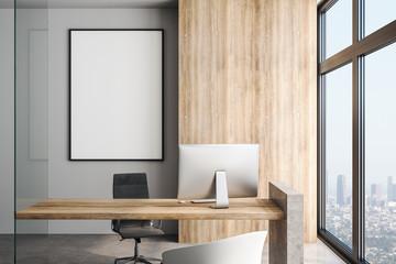 White blank poster on concrete wall in modern office in skyscraper