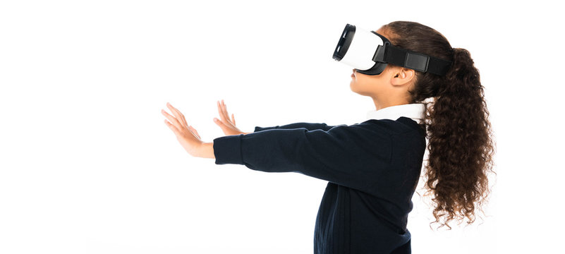 panoramic shot of african american schoolgirl using virtual reality headset isolated on white