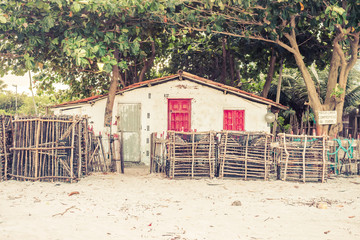 Fish cages/traps in front of a fisherman's house at the beach on Itamaraca island, Brazil