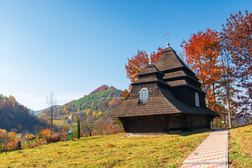 Church of the Archangel Michael - UNESCO World Heritage. old wooden building in mountains. wonderful sunny autumn weather. trees in fall foliage. cloudless sky