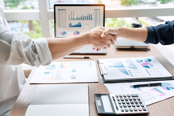 Business handshake after agreement meeting or negotiation finishing up dealing project, partnership approval and deal concept.
