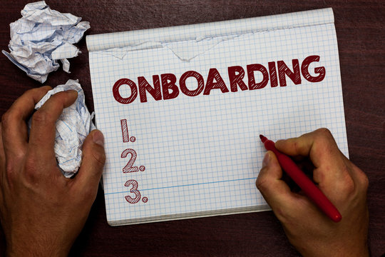 Word writing text Onboarding. Business concept for Action Process of integrating a new employee into an organization Man holding marker notebook page crumpled papers several tries mistakes