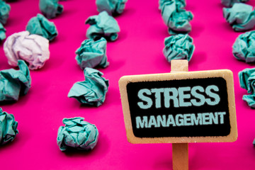Text sign showing Stress Management. Conceptual photo Meditation Therapy Relaxation Positivity Healthcare Blackboard with white letter pink base much green paper lobs big white lob