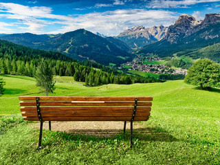 Bench for enjoying amzing panoramic view of dolomites in summer
