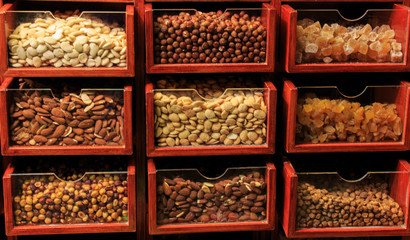 Different types of nuts in wooden displays in the Boqueria market