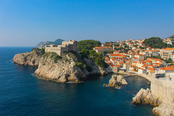 View of Dubrovnik and it's city wall from the Adriatic Sea with Fort Lovrijenac