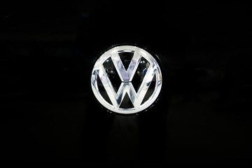 Detail of Volkswagen logo. Volkswagen is a German car manufacturer headquartered in Wolfsburg, Germany, established in 1937.