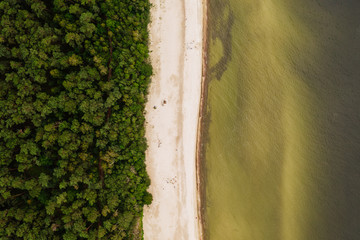 Aerial top-down view of a remote location on the Baltic sea shoreline.
